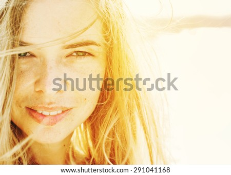 Portrait Of Young Beautiful Woman with Long Hair in Sunlight. Warm Color Toned - stock photo