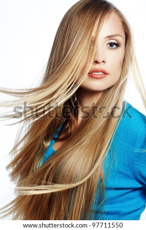 Portrait of young beautiful woman with long strong blond hair - stock photo