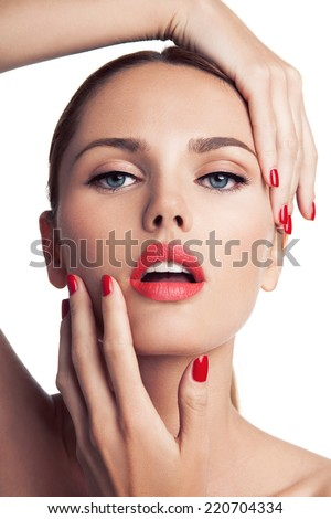 Portrait of young beautiful woman with makeup, blue eyes, red lips and manicure, white background. - stock photo