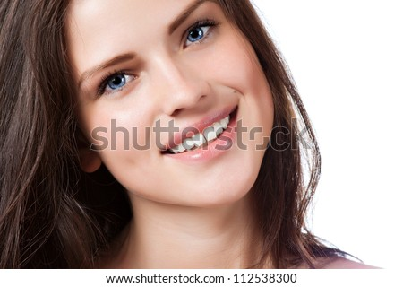 Portrait of young beautiful woman with perfect smile - stock photo