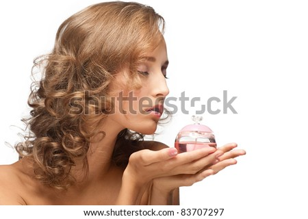 Portrait of young beautiful woman with perfume - stock photo