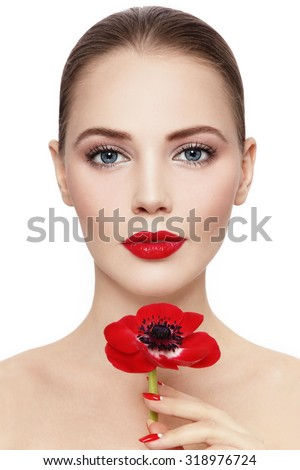 Portrait of young beautiful woman with red flower over white background