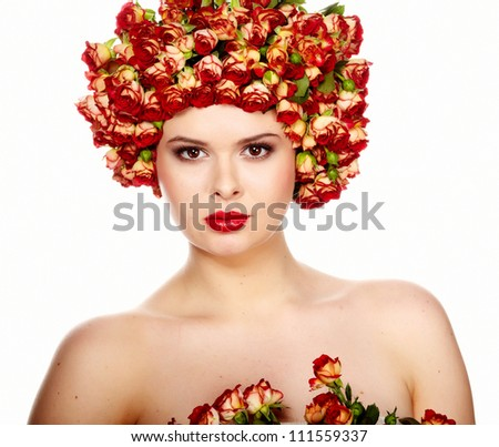 Portrait of young beautiful woman with roses in hair, on white background