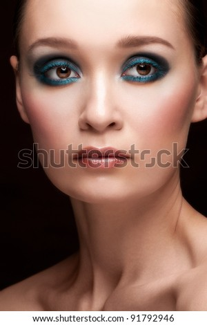 Portrait of young beautiful woman with smoky eyes