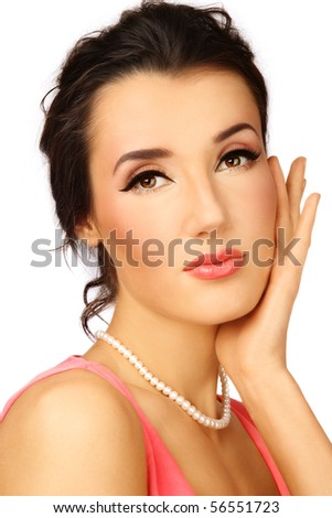Portrait of young beautiful woman with stylish coral make-up touching her face - stock photo