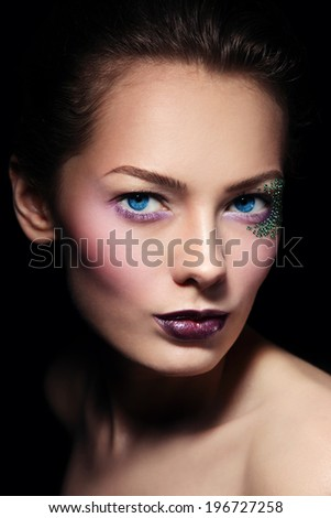 Portrait of young beautiful woman with stylish glitter make-up, selective focus