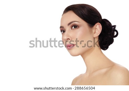 Portrait of young beautiful woman with stylish hair bun over white background, copy space - stock photo