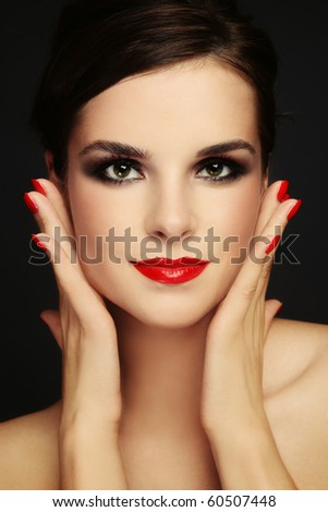 Portrait of young beautiful woman with stylish make-up - stock photo