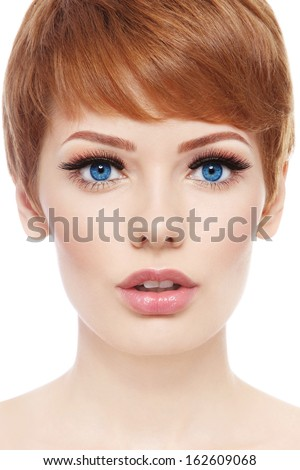 Portrait of young beautiful woman with stylish short haircut and fresh make-up over white background - stock photo