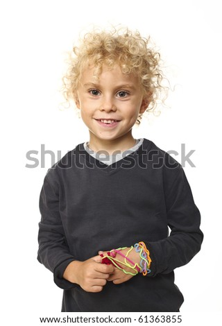 portrait of young blond boy on white background