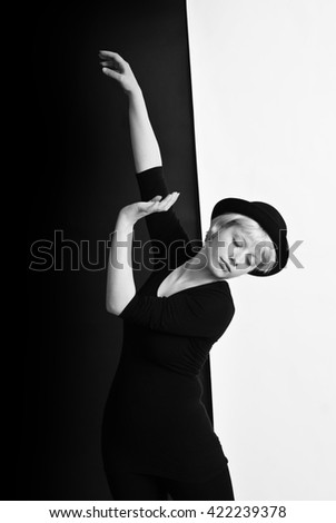 Portrait of young blond woman - circus pantomime posing on black and white background - Black and White Photography - stock photo