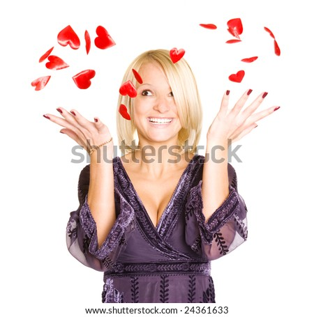 Portrait of young blond woman with red valentine hearts. Isolated over white.