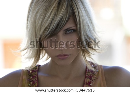 Portrait of young blond woman with trendy hairstyle