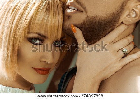 Portrait of young blonde sexy woman with her boyfrined outdoors - stock photo
