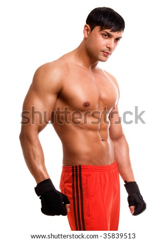Portrait of young bodybuilder man isolated on white.