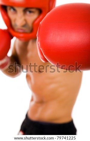 Portrait of young Boxer fighter with boxing helmet and gloves over white background. focus on gloves - stock photo