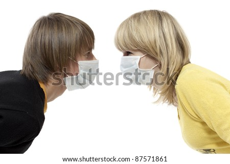 Portrait of young boy and girl in respirator bandage on - stock photo