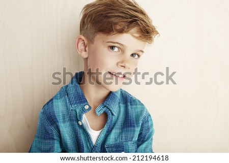 Portrait of young boy in checked shirt  - stock photo
