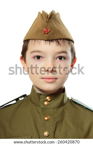 Portrait of young boy in Soviet military uniform isolated on white background - stock photo