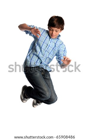 Portrait of young boy jumping isolated over white background - stock photo