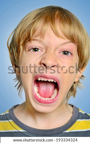 portrait of young boy scream - stock photo