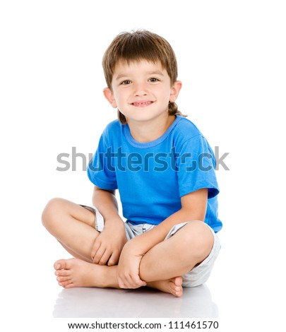 Portrait of young boy sitting isolated over a white background - stock photo