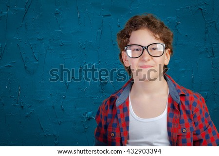 Portrait of young boy wearing glasses - stock photo