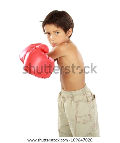 portrait of young boy with boxing glove - stock photo