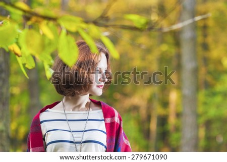 Portrait of Young Brunette Female  in The Forest. Horizontal Image Composition - stock photo