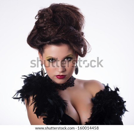 Portrait of young brunette girl in fashion style