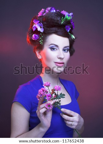 Portrait of young brunette with flowers in her hair