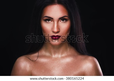 Portrait of young brunette with oil patches on the skin - stock photo