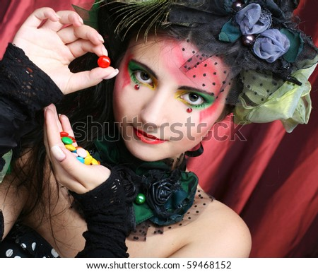 Portrait of young brunette with sweets.