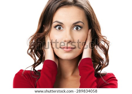 Portrait of young brunette woman covering with hands her ears, isolated on white background - stock photo