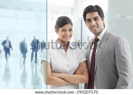 Portrait of young business colleagues in office - stock photo