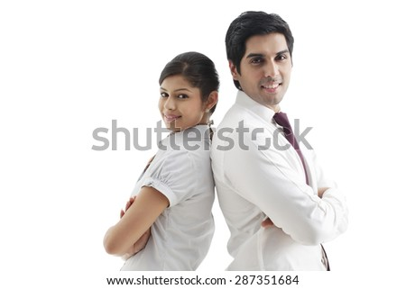 Portrait of young business coworker standing back to back over white background - stock photo