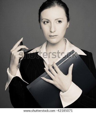 portrait of young business lady with folders and pen in her hands
