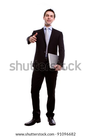 Portrait of young business man giving a hand shake with laptop  against white background - stock photo