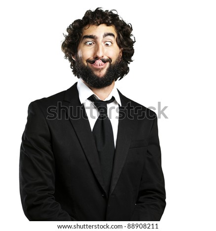 portrait of young business man showing the tongue over white background - stock photo