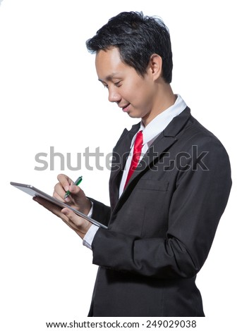 Portrait of young business man using tablet , business concept of write on tablet