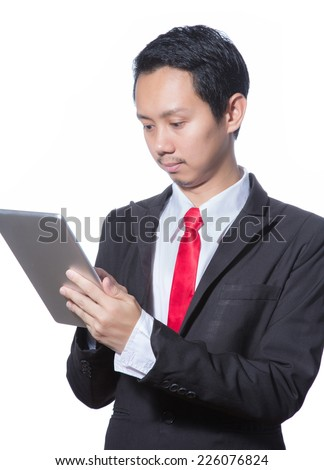 Portrait of young business man using tablet, isolated over white background