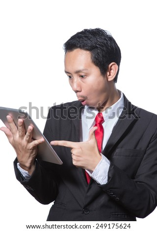 Portrait of young business man using tablet thumb up hand point to tablet, concept of success, happy and positive result - stock photo