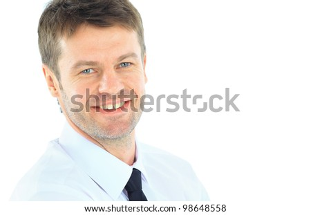 Portrait of young business man with folded hands against white background - stock photo