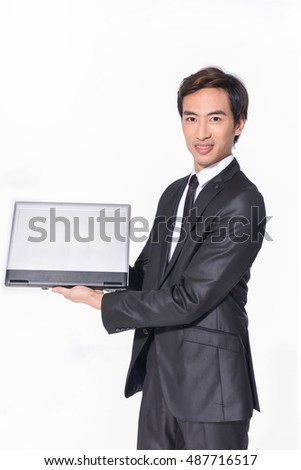 portrait of young business men holding laptop