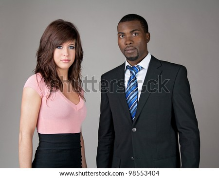 Portrait of young business partners, Caucasian woman and African American man. - stock photo