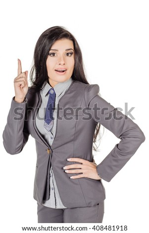 portrait of young business woman in gray suit pointing up and showing copy space. isolated on white background. business and lifestyle concept - stock photo