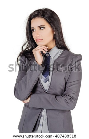portrait of young business woman in gray suit thinking. isolated on white background. business and lifestyle concept - stock photo