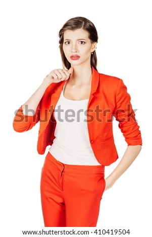 portrait of young business woman in red suit gesturing a cutting motion on her throat. isolated on white background. business and lifestyle concept