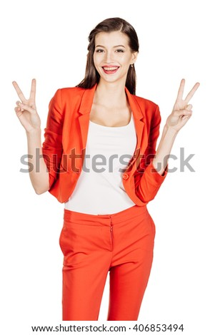 portrait of young business woman in red suit making the victory symbol. isolated on white background. business and lifestyle concept - stock photo