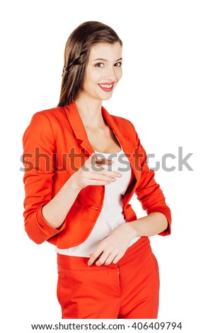 portrait of young business woman in red suit pointing at you and showing copy space. isolated on white background. business and lifestyle concept